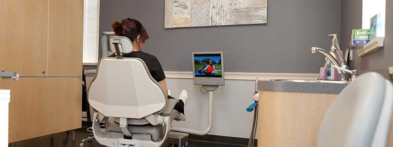 patient watching tv in dental chair