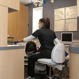 Dentist working with New patient