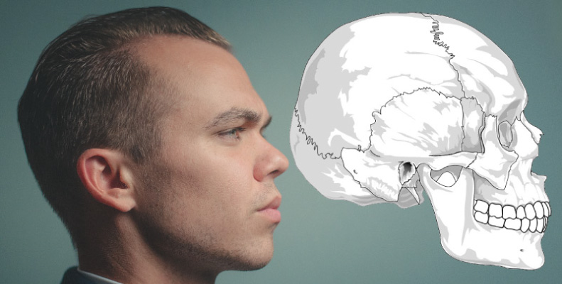 Side profile of brunette man in front of a teal wall next to a drawing of a skull depicting the temporomandibular joint